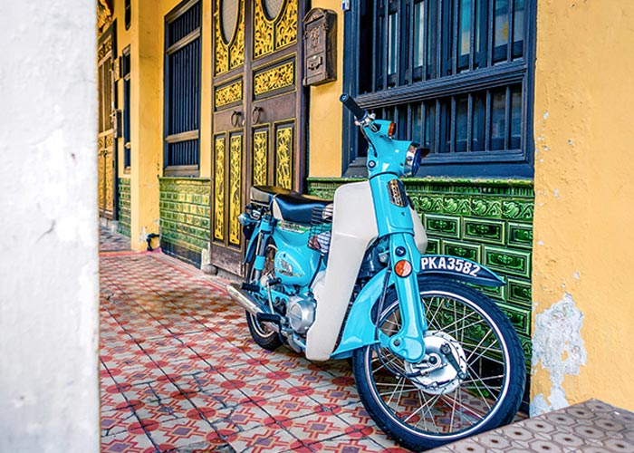 Decorative Facade and A Motorbike in Georgetown